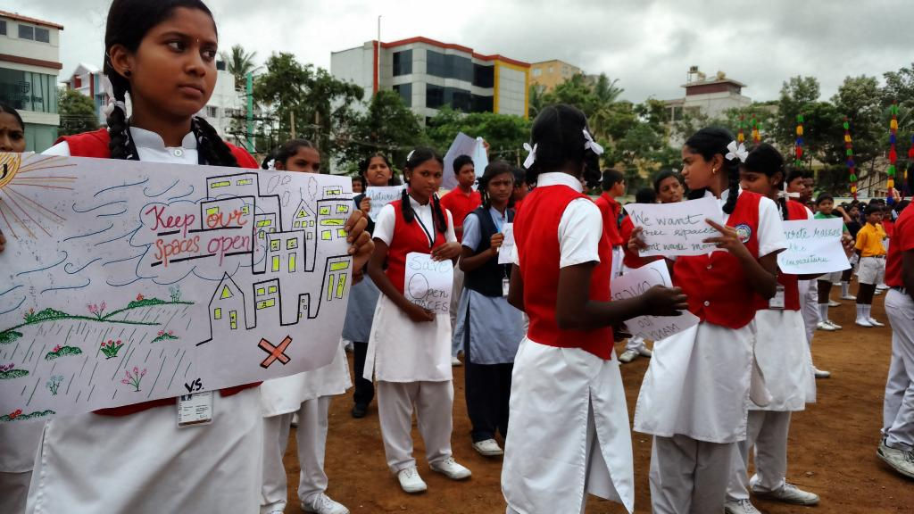 Schoolchildren in Bengaluru stage a protest asking for removal of encroachment from open spaces. Credit: I Change Indiranagar