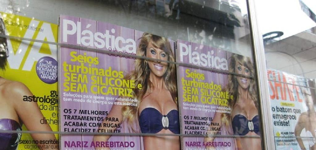 A plastic surgery-themed magazine is displayed in a Brazil storefront. hollywoodsmile310, CC BY-NC-ND