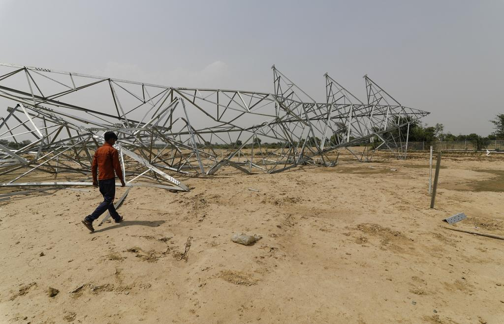 In some places, wind speed peaked 132 km per hour, causing huge damage to electric poles and transformers, plunging several districts of Uttar Pradesh and Rajasthan into darkness. Credit: Vikas Choudhary