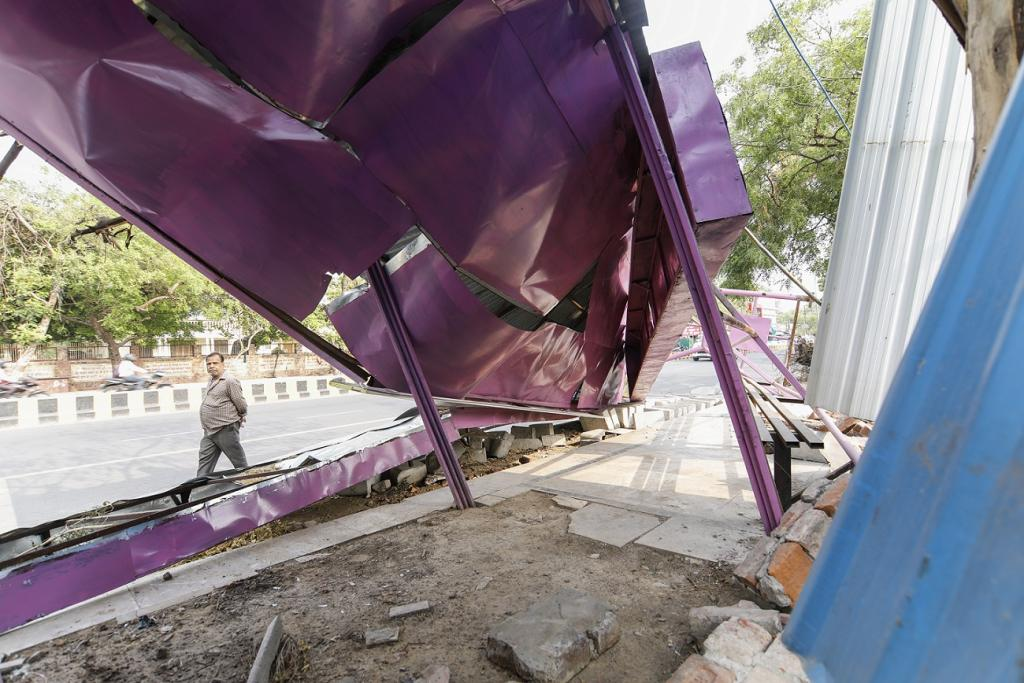 Besides billboards and vehicles, the intense storm damaged bus shelters. Credit: Vikas Choudhary