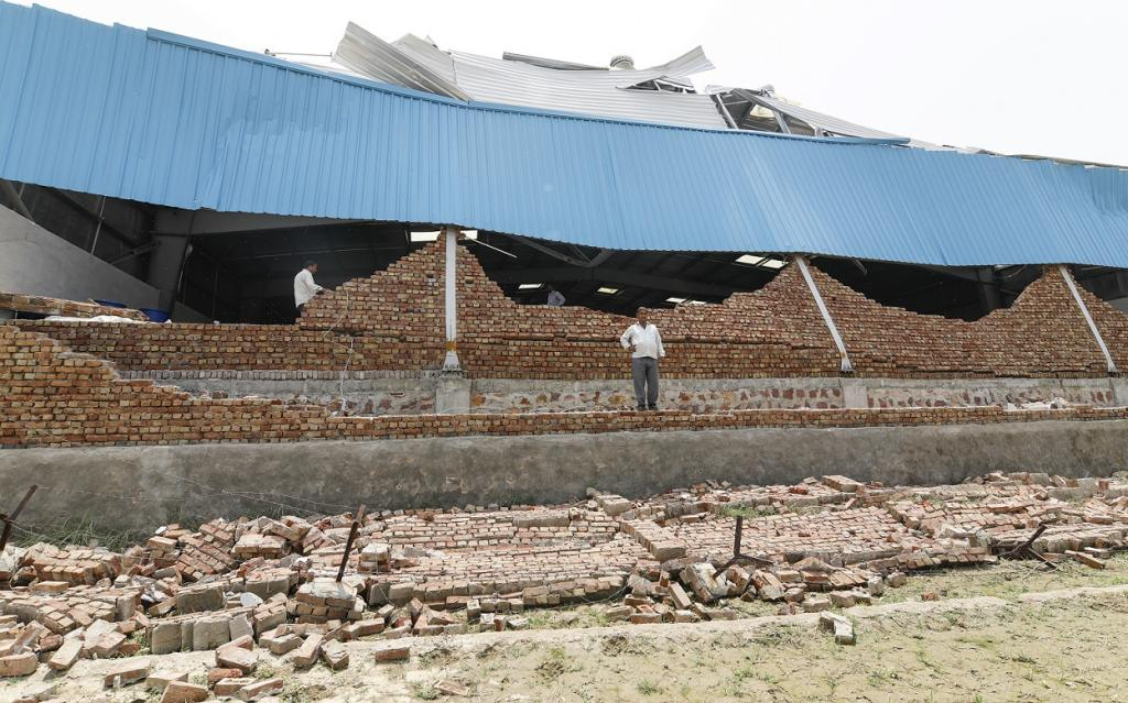 The walls of the honey processing factory and its sheds suffered a considerable damage on May 2, the day high-speed dust storm and thunderstorm lashed eastern part of Rajasthan. Credit: Vikas Choudhary