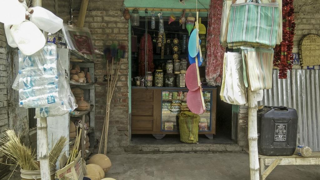 A mix of old and new items stocked at a village store in Northern West Bengal. The presence of plastic packaging and plastic products is difficult to miss, as is the mess it creates in agricultural fields, local drains and eventually the river itself. Cre