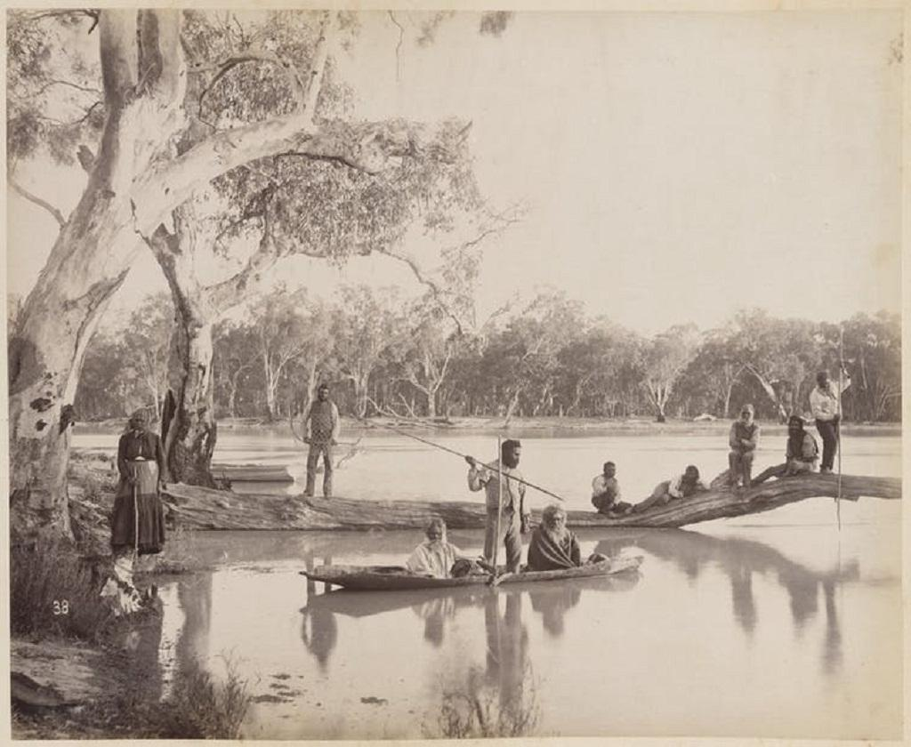 An image from 1886 showing a group of Indigenous Australians posed around the lower Murray River in flood. national_library_of_australia_commons/flickr , CC BY
