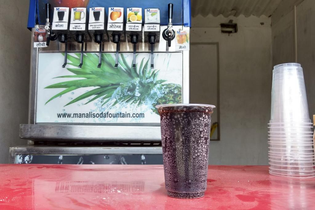Quite the rage, these instant flavoured soda dispensers also dispense a huge number of plastic glasses! Apart from larger stores in small towns like this one in Begu Sarai, you can also find small vans in villages, carrying a portable version of this machine. Credit: Siddharth Agarwal