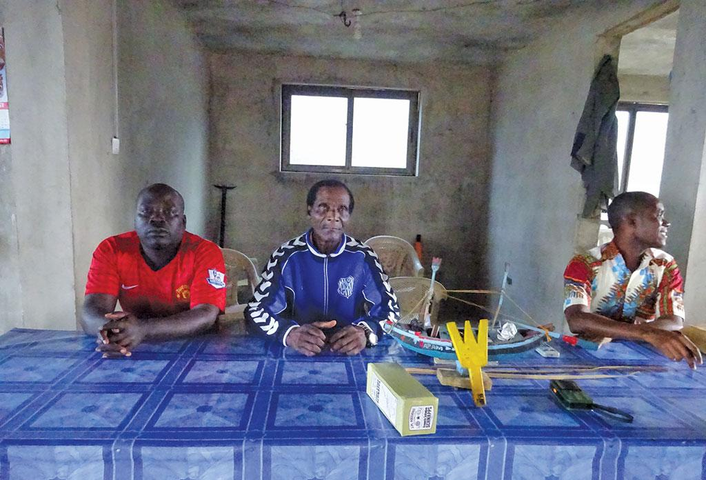Nana Kobina Caique (centre), chief fisherman of Ghana's Apam fishing community says international vessels, who bribe local officials, often escape after destroying the community's nets