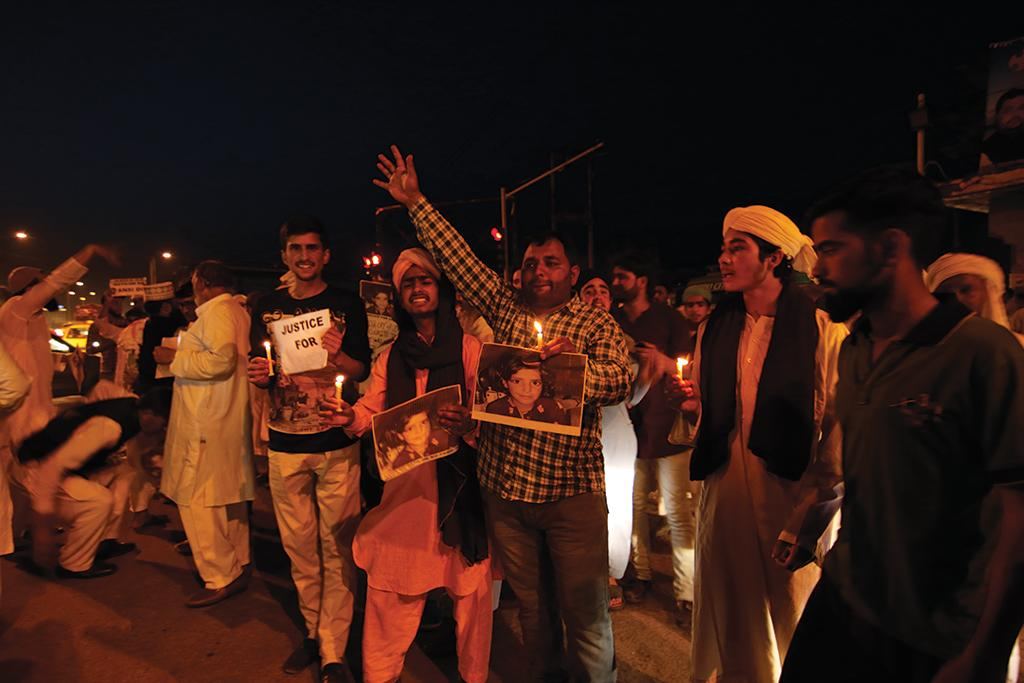 A candle light protest in Jammu city on April 14 demanding action against the accused