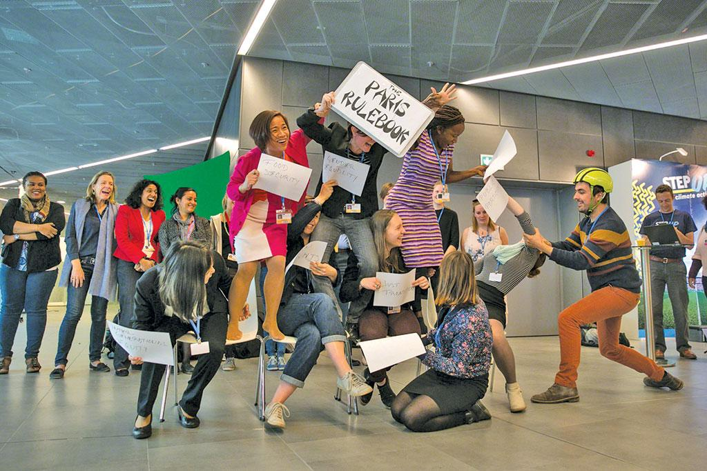 Members of the civil society form a human pyramid representing the eight fundamental elements of the Paris Agreement rule book: human rights, public participation, indigenous people's rights, just transition, gender, food security, ecosystem integrity and