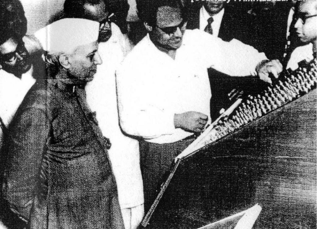 Samarendra Kumar Mitra showing ISI's analogue computer to Nehru in 1953