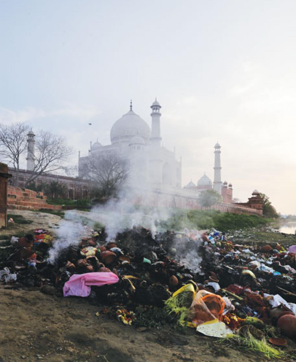 A pile of burning trash near the Taj Mahal in Agra