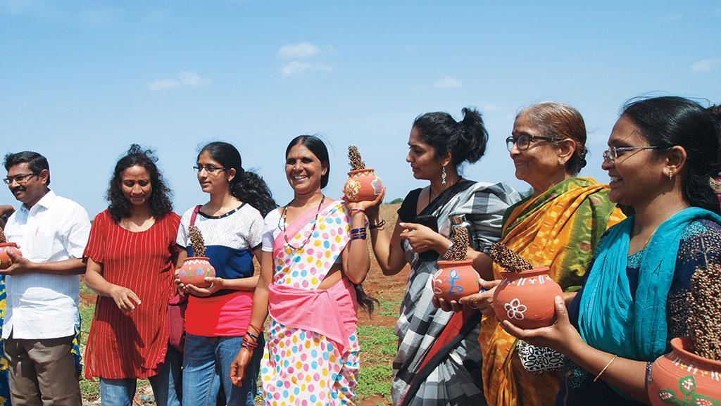 Shakribai (centre) of Arjun Nayak Thanda village welcomes urban consumers to her world of biodiverse farming