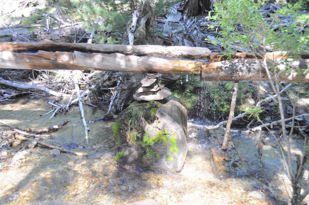 A tree trunk is made hollow to allow water run through it which is then connected to a wooden water mill to run it, such innovations are destroyed in flash floods. Credit: Zofeen T Enrahim
