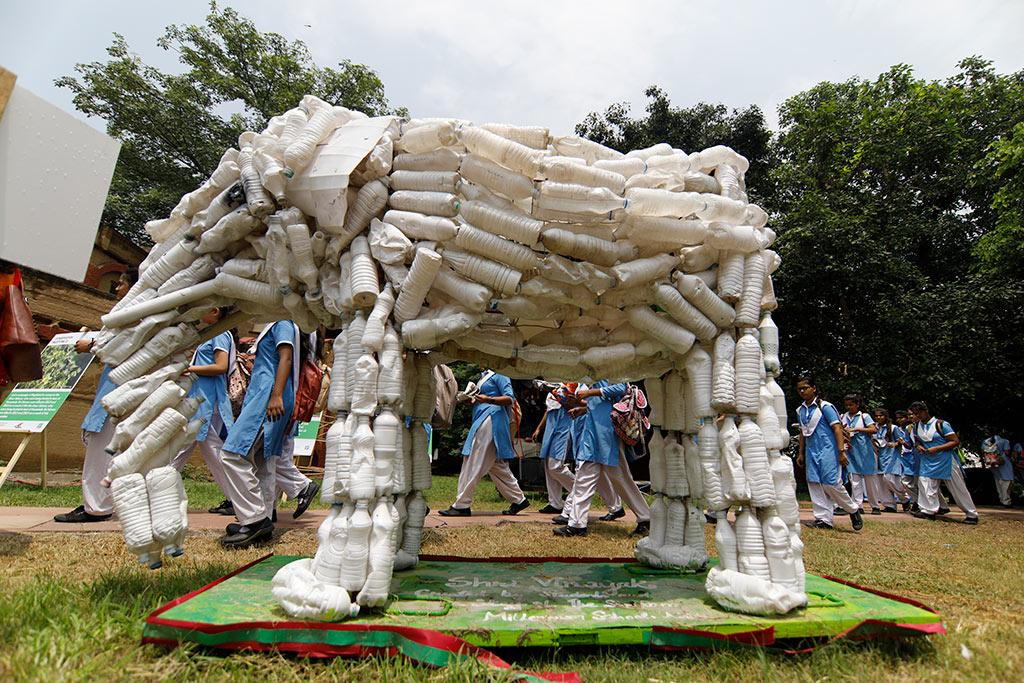 An art installation showing an elephant made from used plastic bottles.