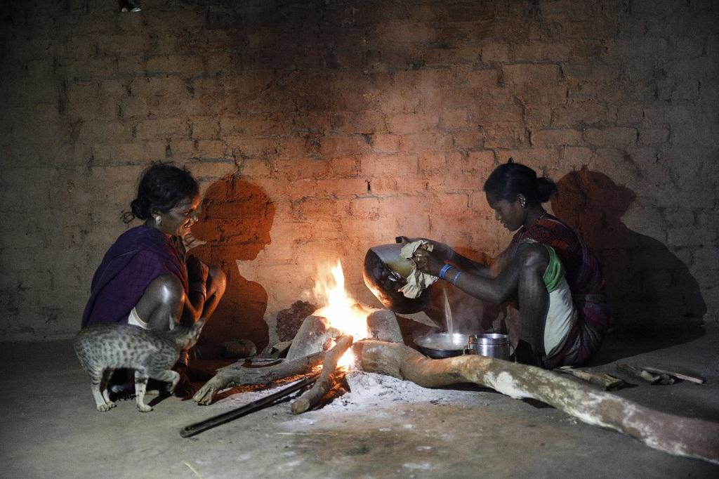 Baiga women prepare rice from sikiya in Dindori district's Silpidi village