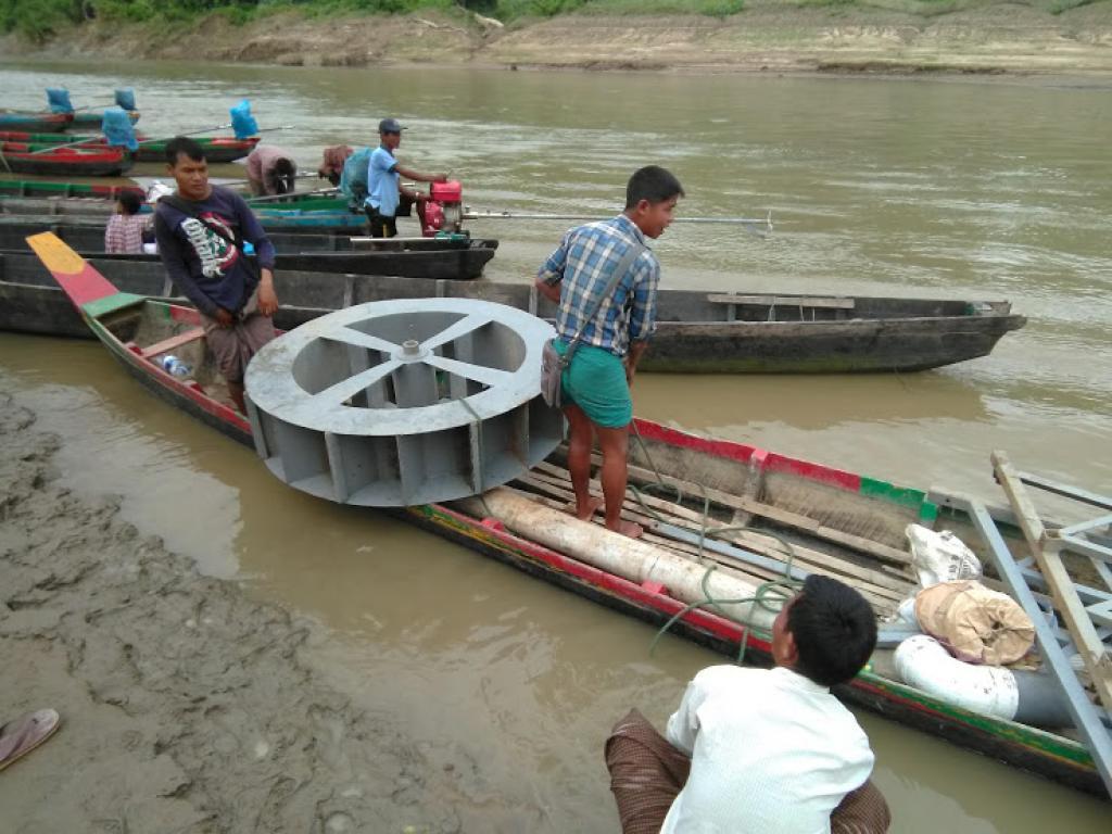 Installing the pico hydropower plant. Credit: Oporajeo