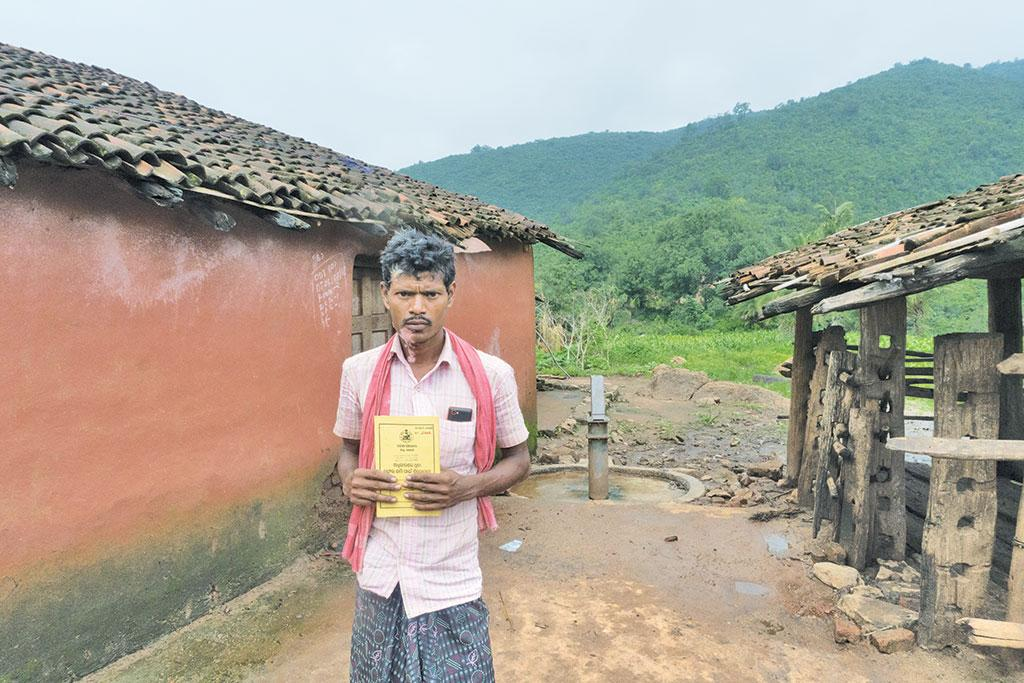 Rusi Majhi of Dukrigura village of Kalahandi shows title deeds granted under the Forest Rights Act. The government has earmarked his 0.46 ha for industrial land bank
