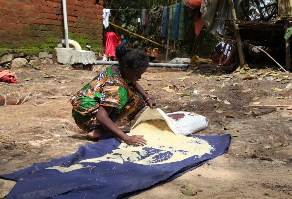 """Luckily this sack of rice has not washed away. We cannot afford to throw it in the waste. I have washed it properly. We can use it once it dries,"" says Meenakshi, as she dries a sack of salvaged rice"