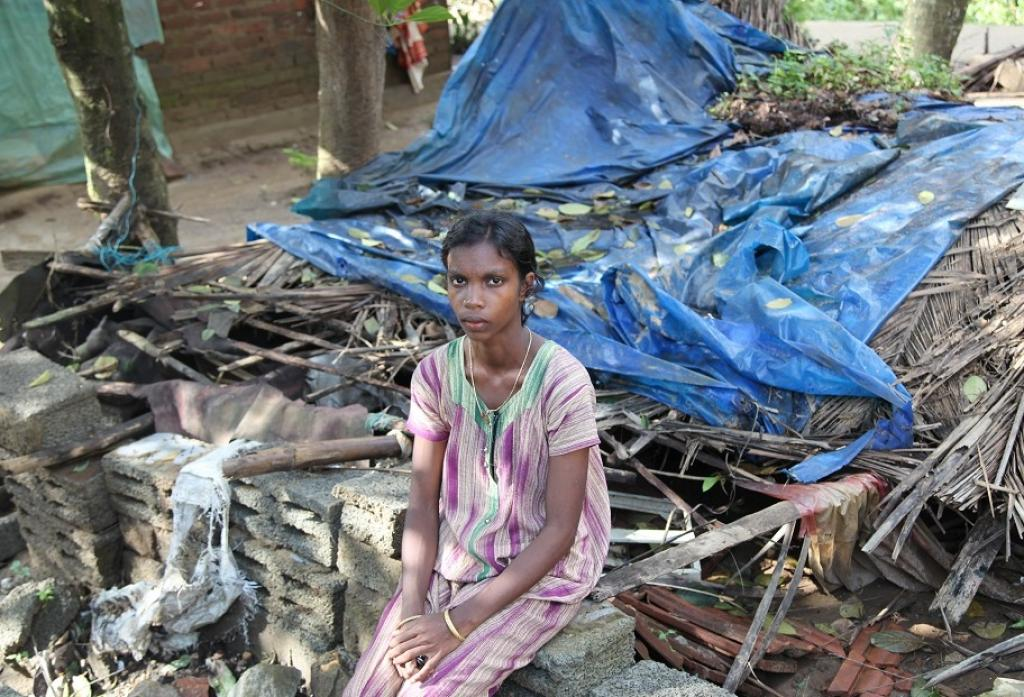 """I want to continue my TTC (Teacher's Training Course), but right now survival has become our primary concern. I will have to go for daily wage work at least for a year, to come out of the situation we are in,"" says Shyama while sitting in front of their house that lay in ruins"
