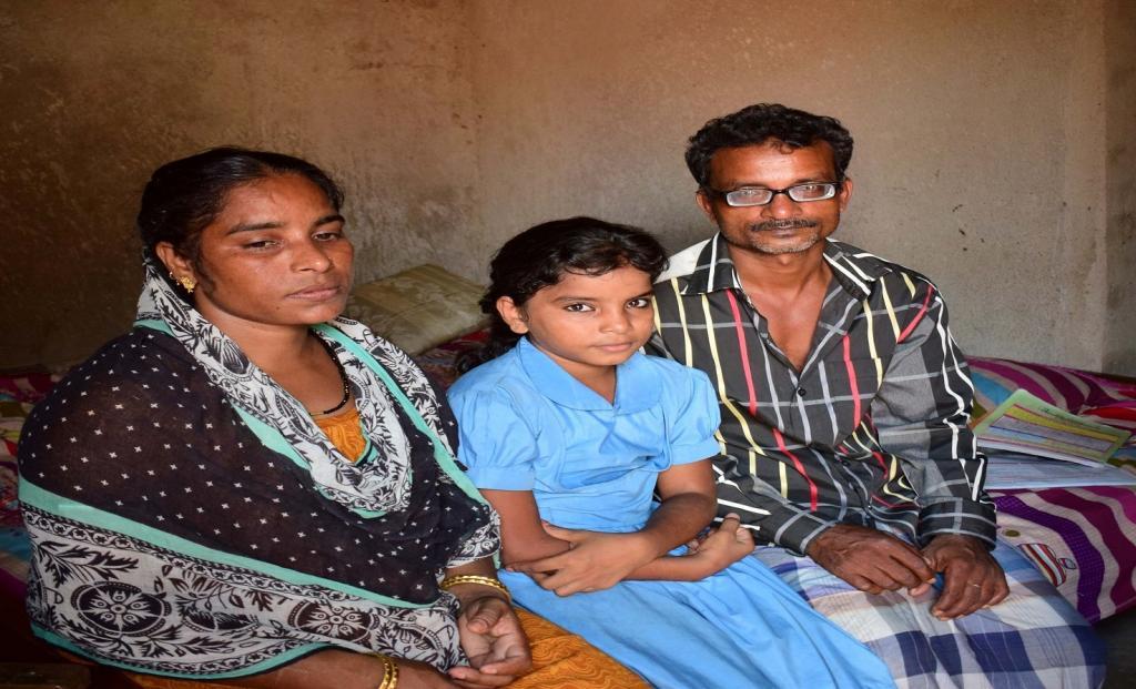 Swalia and her husband SK Faku with their youngest daughter. Credit: Priya Ranjan Sahu