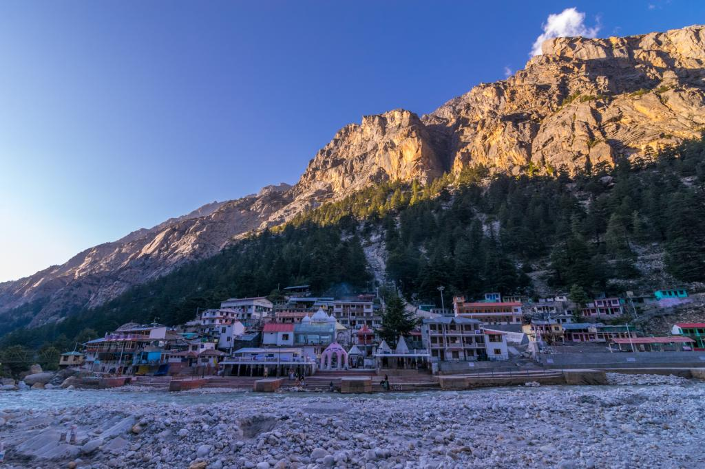 Sunset at Gangotri, which is a part of Uttarakhand's Char Dham pilgrimage network. The Supreme Court asked the Centre why it should not stay the  NGT clearance for an all-weather road network there. Credit: Getty Images
