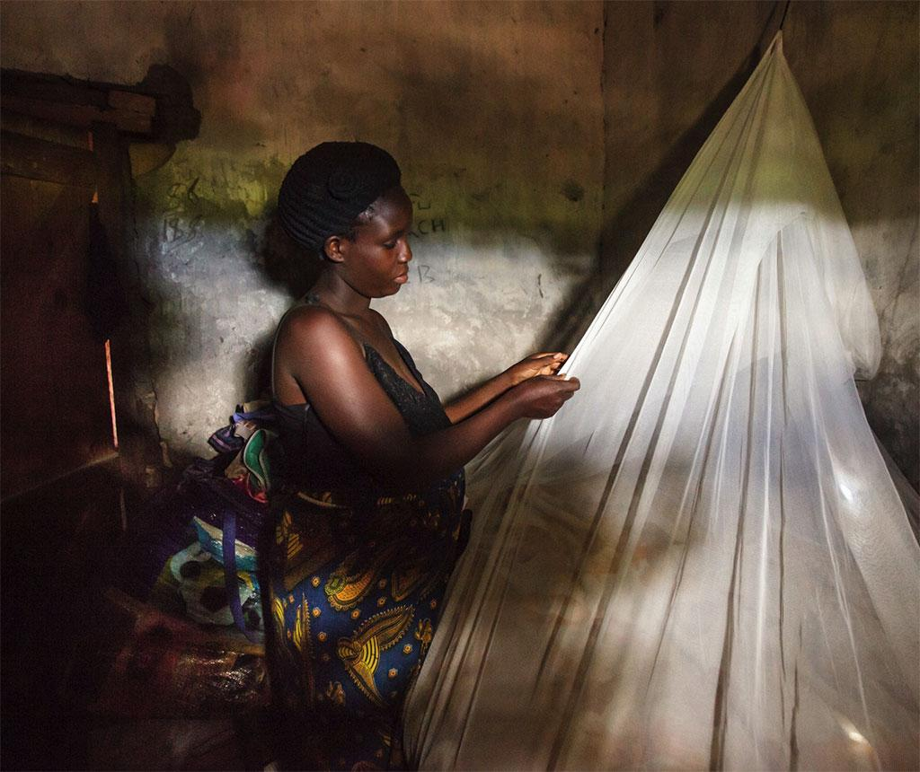 To protect children from complications of malarial infection, governments in Africa provide insecticide-treated mosquito nets free to pregnant women (Credit: USAID)