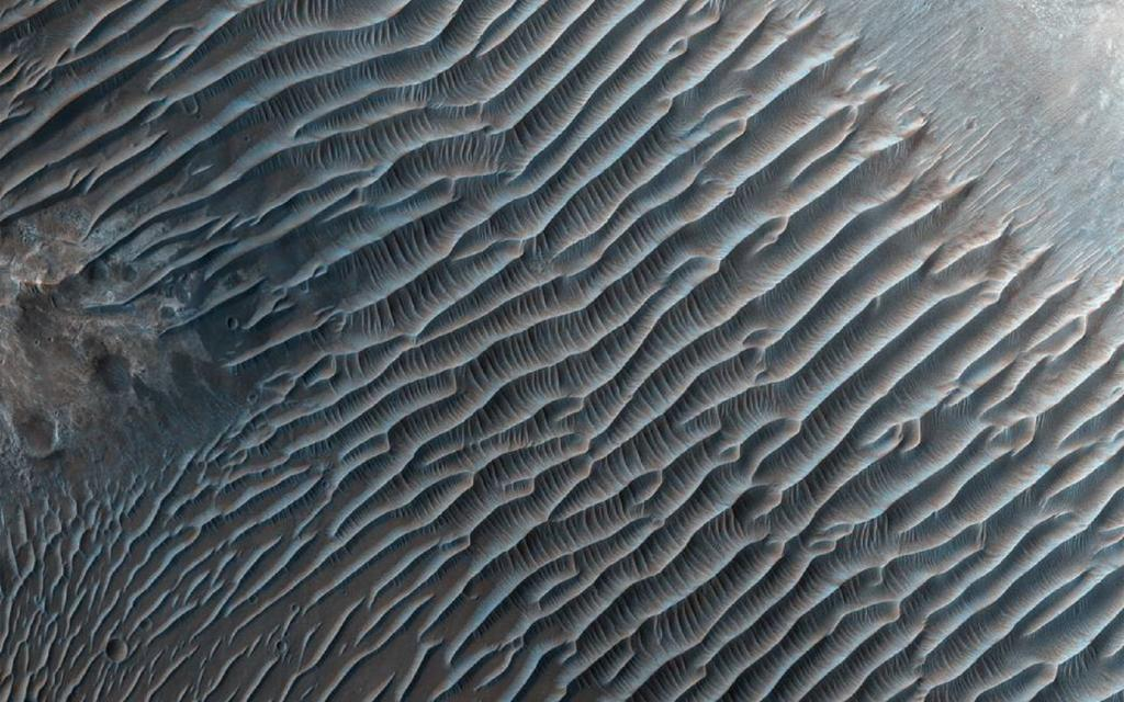 This image from NASA's Mars Reconnaissance Orbiter shows small ripples, about 10 meters apart, located in Her Desher Vallis. Credit:NASA