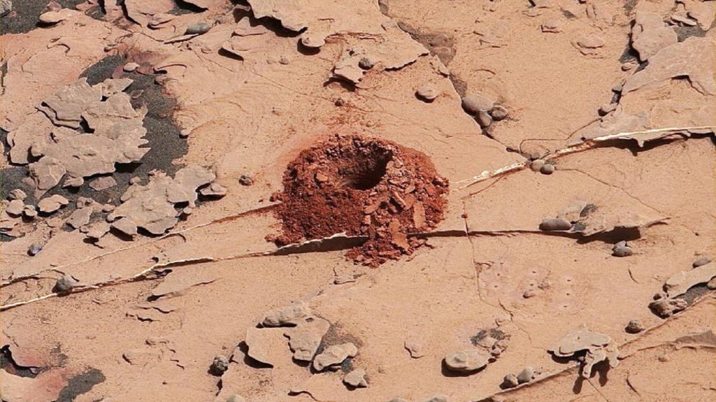 Close-up image of a 2-inch-deep hole produced using a new drilling technique for NASA's Curiosity rover. Credit: NASA