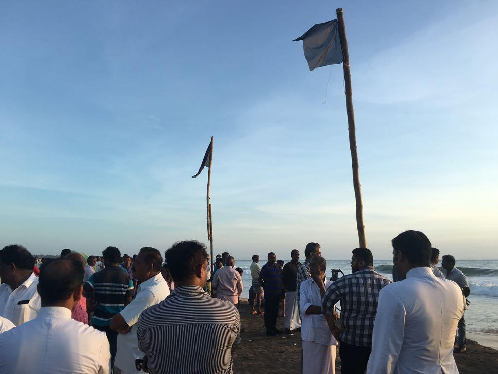 File picture of fishermen waiting for the rescue boats to return on December 3, 2017 at Poonthura beach in Thiruvananthapuram. Credit: Rejimon Kuttappan