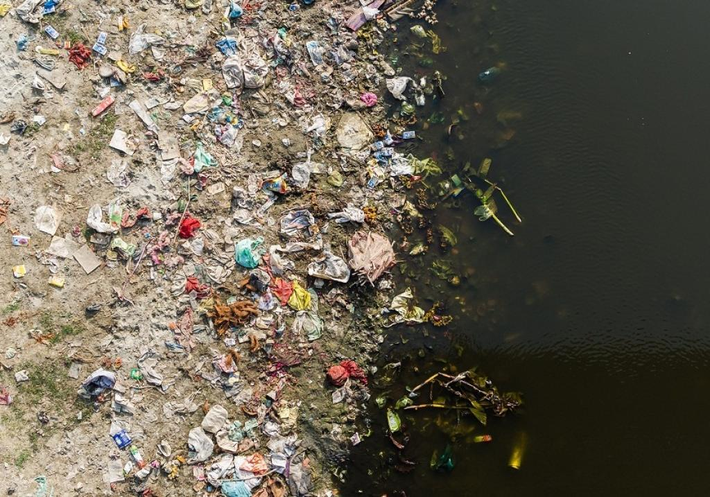 A polluted river bank. Credit: Getty Images