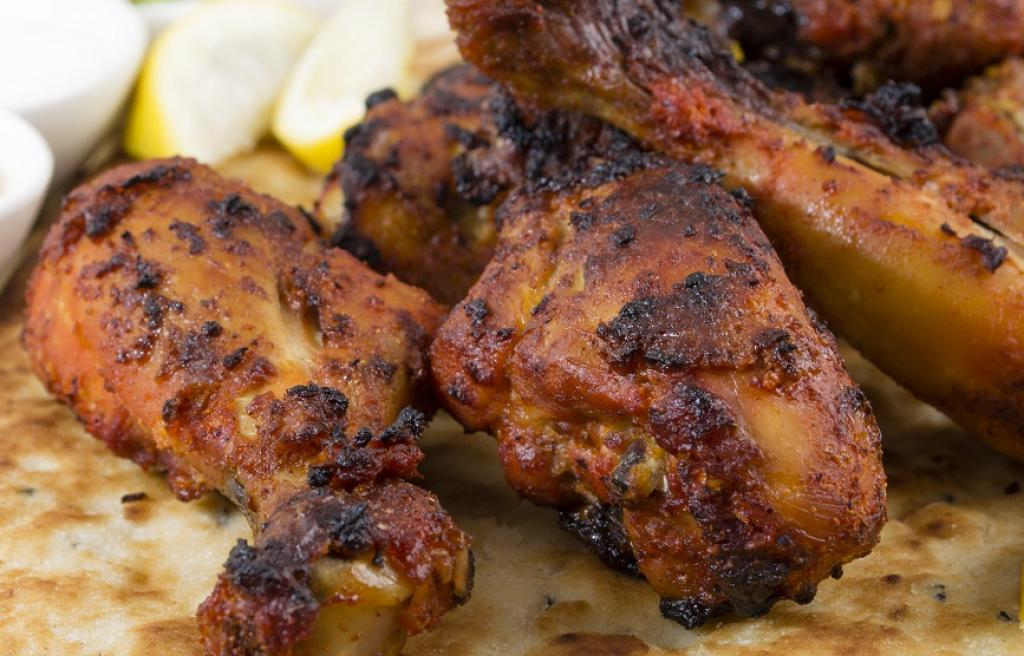Tandoori chicken and naan bread. Credit: Getty Images