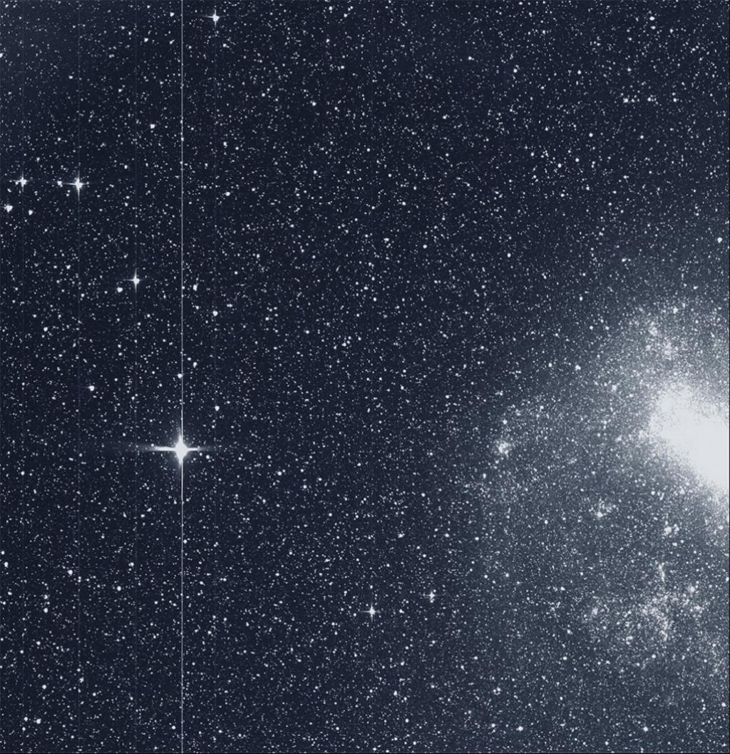 "TESS took this snapshot of a large magellanic cloud (right) and the bright star R Doradus (left) with just a single detector of one of its cameras in August 2018. The frame is part of a swath of the southern sky TESS captured in its ""first light"" science image as part of its initial round of data collection. Credit: NASA/MIT/TESS"