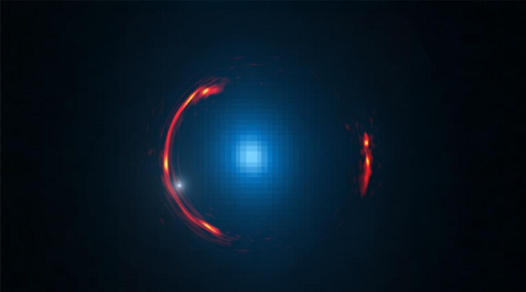 New analysis of an image taken by the Atacama Large Millimeter/submillimeter Array (ALMA), led by a Stanford astrophysicist, reveals evidence that a dwarf dark galaxy–a tiny halo companion of a much larger galaxy–is lurking nearly 4 billion light-years away. Composite image of the gravitational lens SDP.81 shows the more distant galaxy (red arcs) and the nearby lensing galaxy (blue centre object). By analyzing the distortions in the ring, astronomers have determined that a dark dwarf galaxy (indicated by white dot near left lower arc segment) is lurking nearly 4 billion light-years away. Image credit: Y. Hezaveh/ALMA