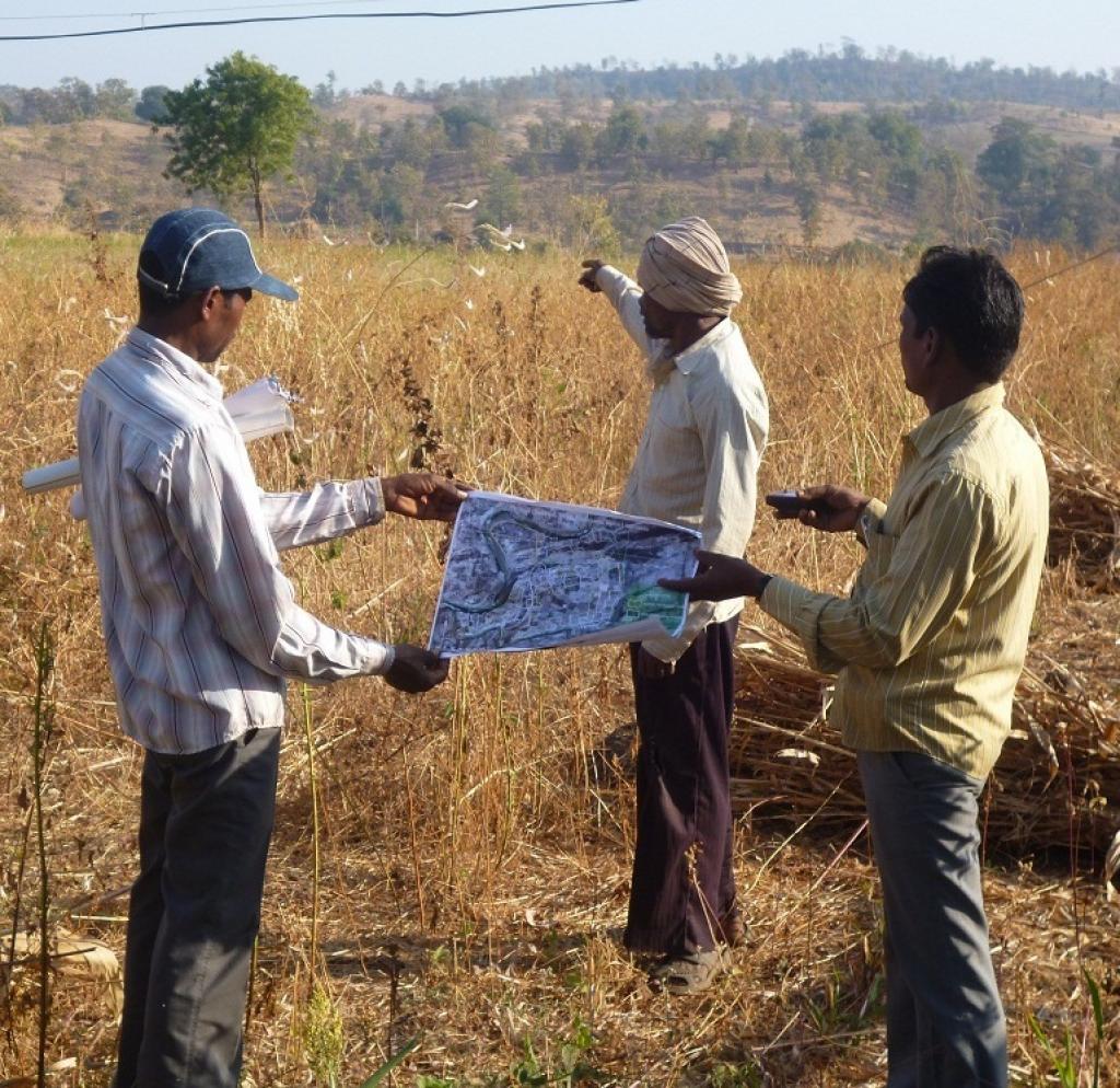 Mapping work done by residents of Narmada district in Gujarat using a GPS device to demarcate their land under Forest Rights Act. Photo for representational purposes. Credit: Anupam Chakravartty