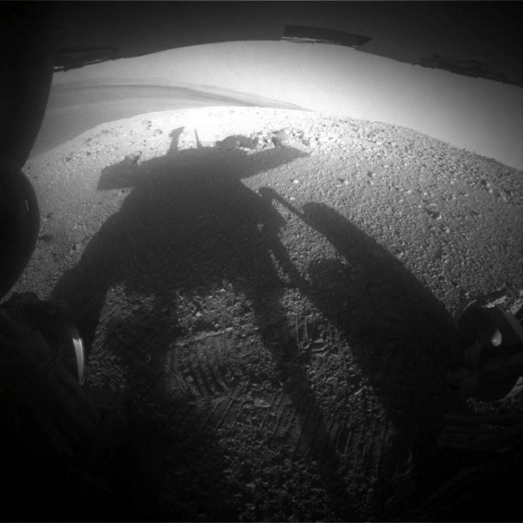 Selfie moment: Opportunity caught its own silhouette in this late-afternoon image taken by the rover's rear hazard avoidance camera. The rover, designed to travel only 1,100 yards and operate on the Red Planet for 90 Martian days, has travelled over 45 kilometres and logged its 5,000th Martian day in February, 2018. Photo: NASA
