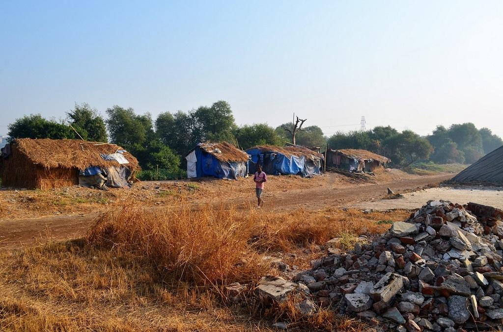 These workers earn barely Rs 7,000 per month. They are provided with rice, dal and oil to cook in temporary, often illegal shacks set up near the salt pans. Photo: Gajanan Khergamker