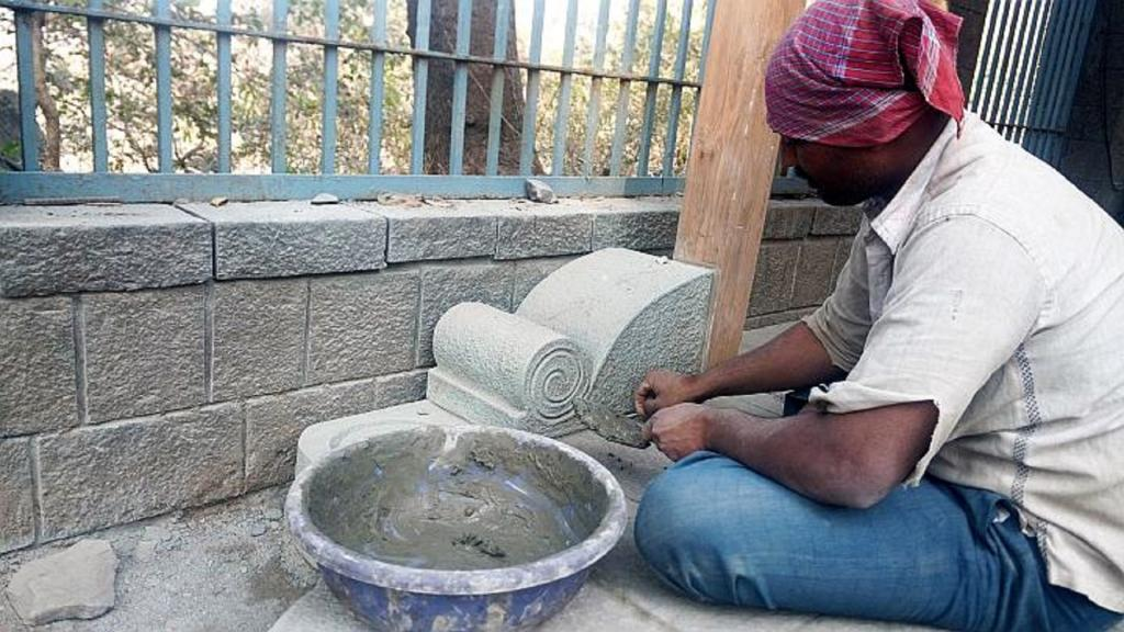 Most of the present-day Wadars are educated but break stones as its part of their family tradition. Nagar-based Sunil Bhagwan Pawar works to re-create an artistic carving  along the wall circumventing the Caves at Elephanta Island Photo: Gajanan Khergamker