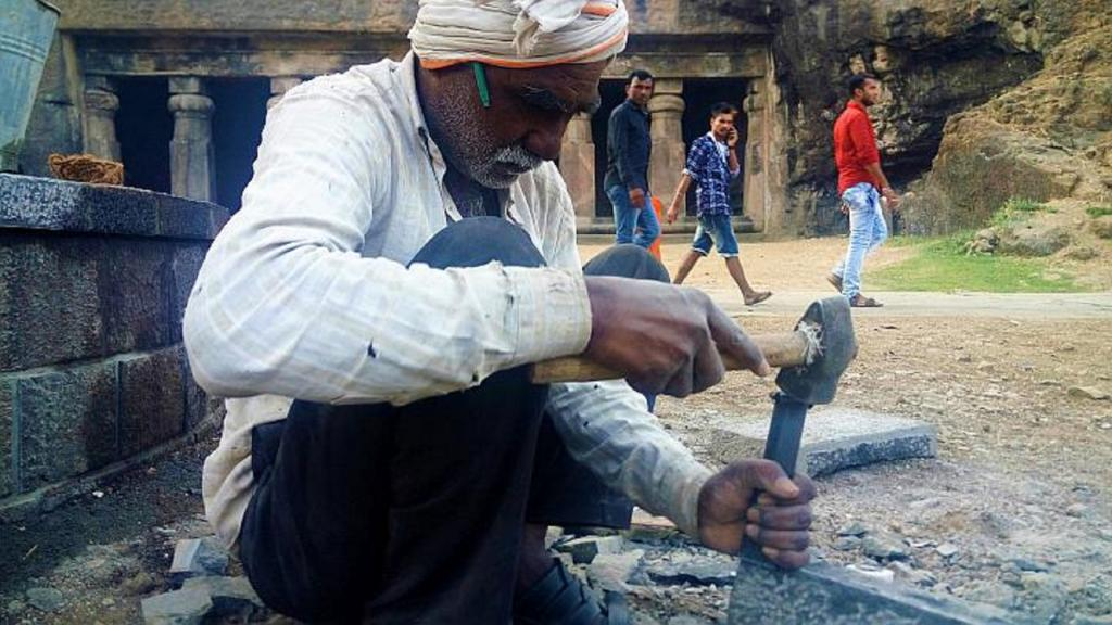 Fifty-six-year-old Wadar Bhagwan Bhikaji Pawar chips away at a rock with expertise much like his father and septuagenarian Bhikaji, who also breaks stones back at Pathardi village in Ahmednagar district. Photo: Gajanan Khergamker