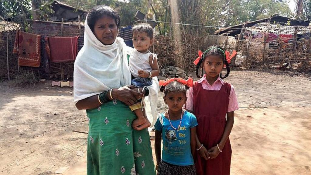 Sheelu Patel with her daughters awaits the next tremor in the open, refusing to stay within their huts at Amboli Village. Photo: Gajanan Khergamker