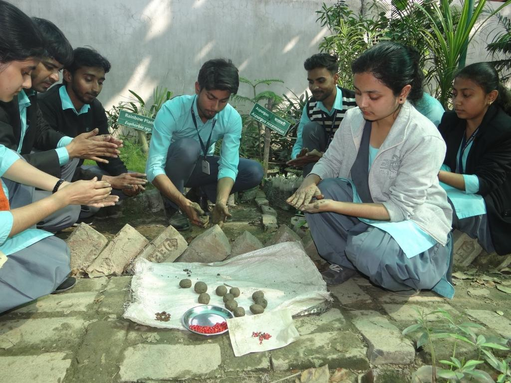 Schoolchildren preparing the seed bombs. CK Manoj