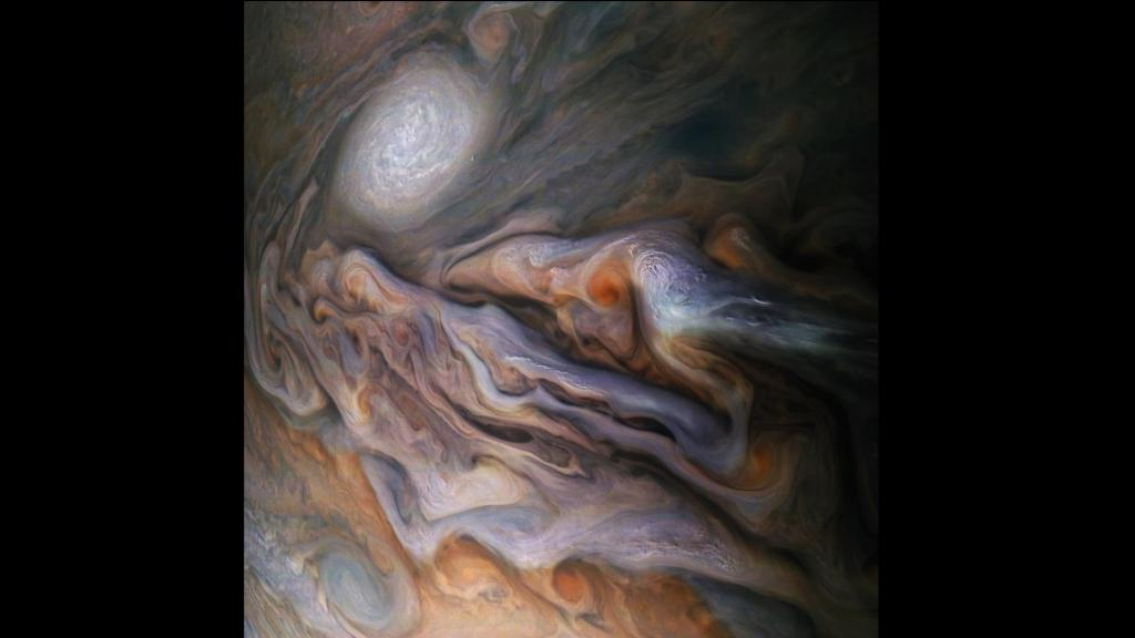 A multitude of magnificent, swirling clouds in Jupiter's dynamic North North Temperate Belt is captured in this image from NASA's Juno spacecraft. Appearing in the scene are several bright-white