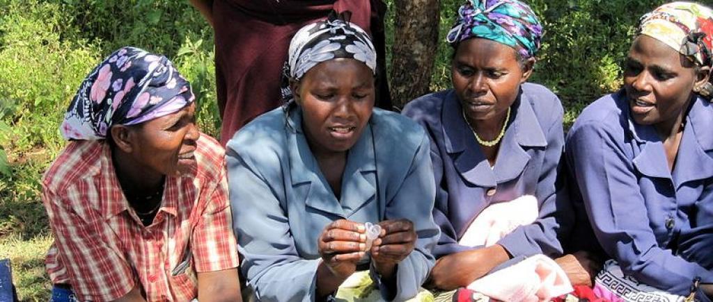 Women in Meru, Kenya, examine menstrual cups. Photo: Wikimedia Commons