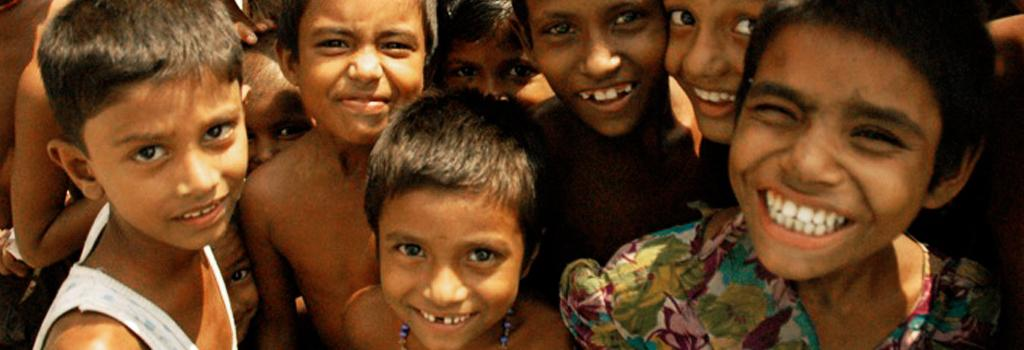 Crowd of smiling children in Bangladesh. Photo: Wikimedia Commons
