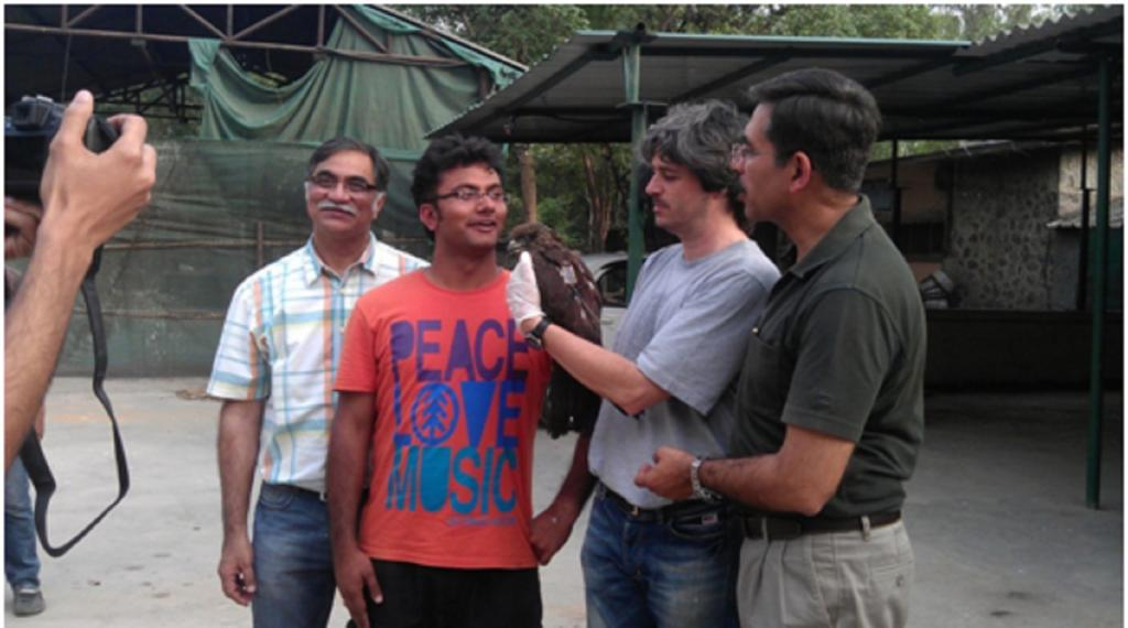 Q Qureshi, Nishant Kumar, Fabrizio Sergio and YV Jhala with a black kite. Photo: ISW