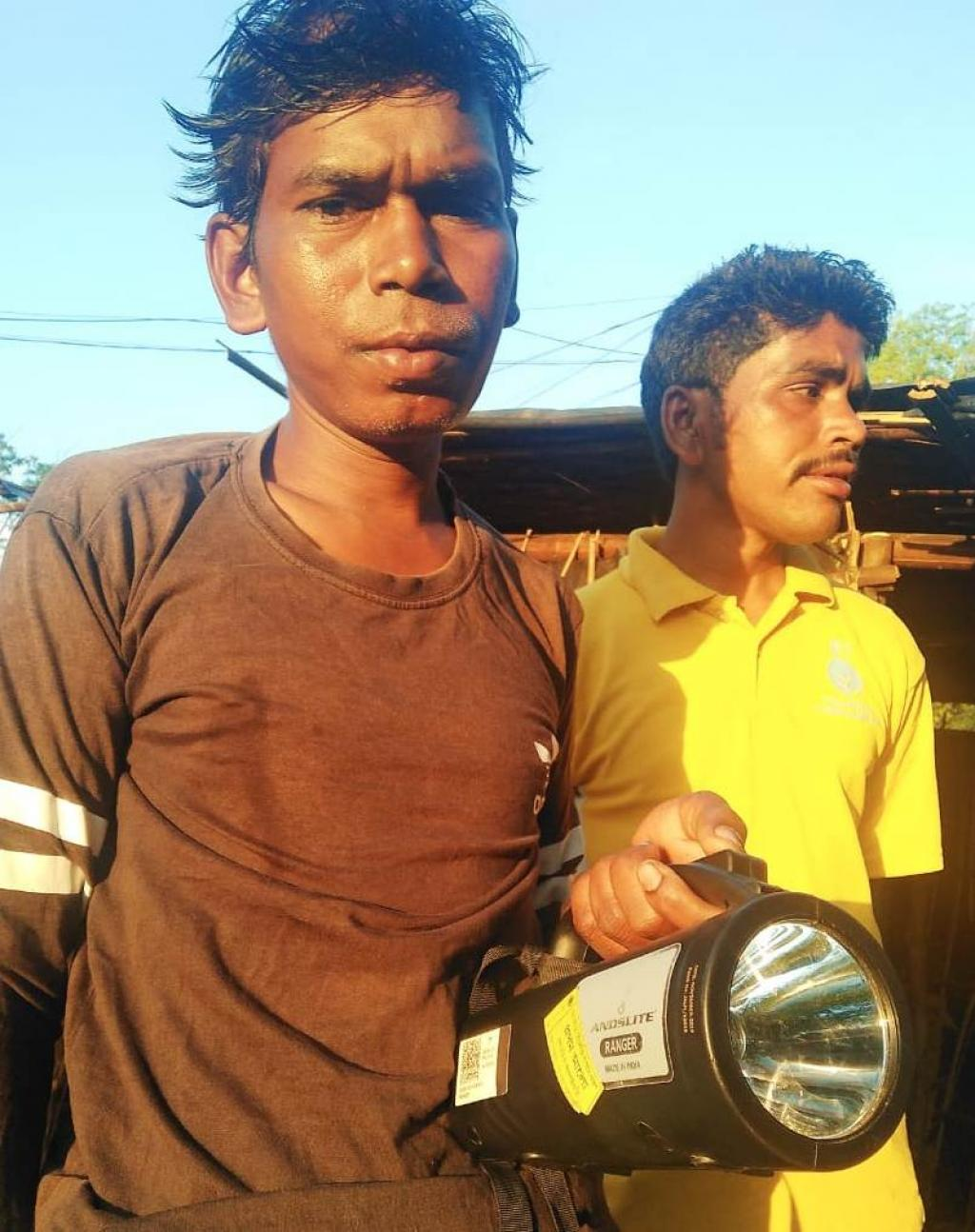A member of Asur tribe bought a light to protect himself from elephants. Photo: Atonu Choudhary