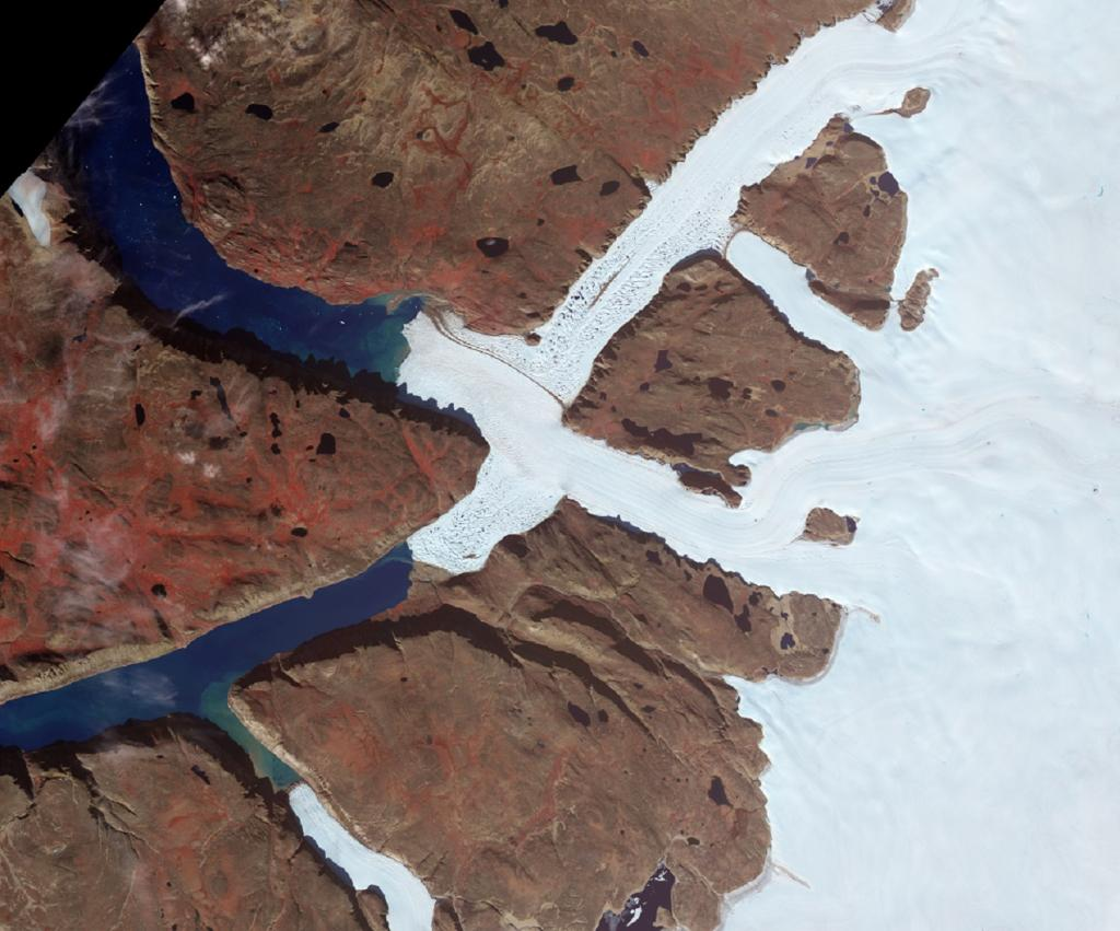 Located in the northwest corner of Greenland, Leidy Glacier is fed by ice from the Academy Glacier. As Leidy approaches the sea, it is diverted around the tip of an island that separates the Olriks Fjord to the south and Academy Cove to the north. The crisscross pattern is the result of ice flowing along the path of least resistance. Photo: NASA/Terra