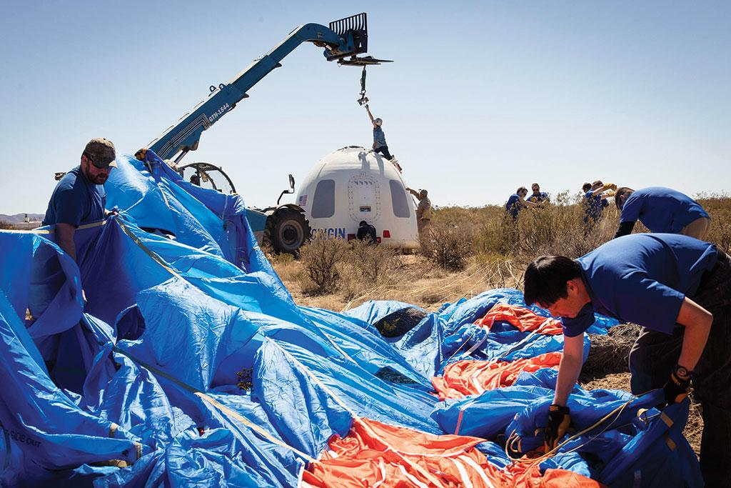 Members of Blue Origin recover a crew capsule after its fifth successful flight and soft landing. Blue Origin's New Shepard is a fully reusable  rocket for suborbital flight