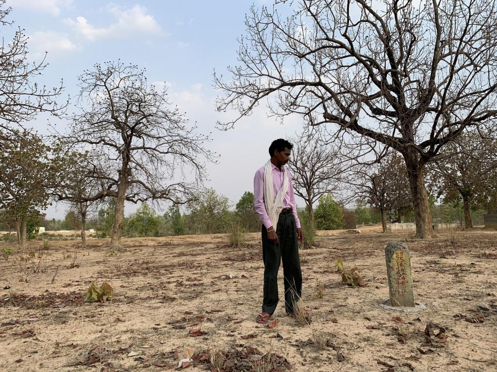 Chhote Lal Singh, a Gond tribal resident of the village and secretary of the Forest Rights Committee, shows the cement pillars erected on his land, pending under FRA. Photo: Ishan Kukreti