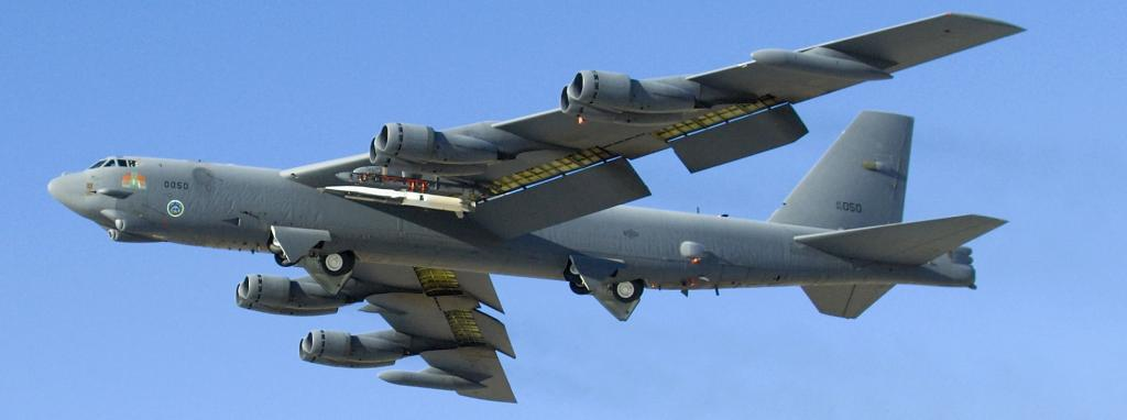 A new-generation weapon, in white, launches from an older one, the B-52 bomber. Mike Cassidy / US Air Force