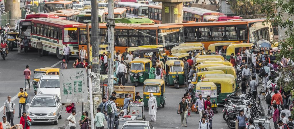 Pedestrians and vehicles on a road in Delhi. Photo: Getty Images