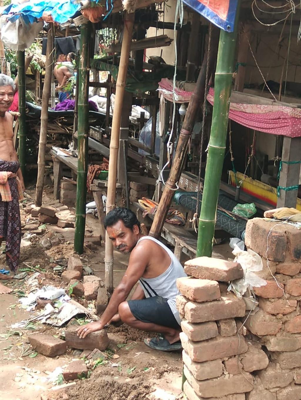 A weaver examining his damaged loom in Haripur village. Photo: Ashis Senapati