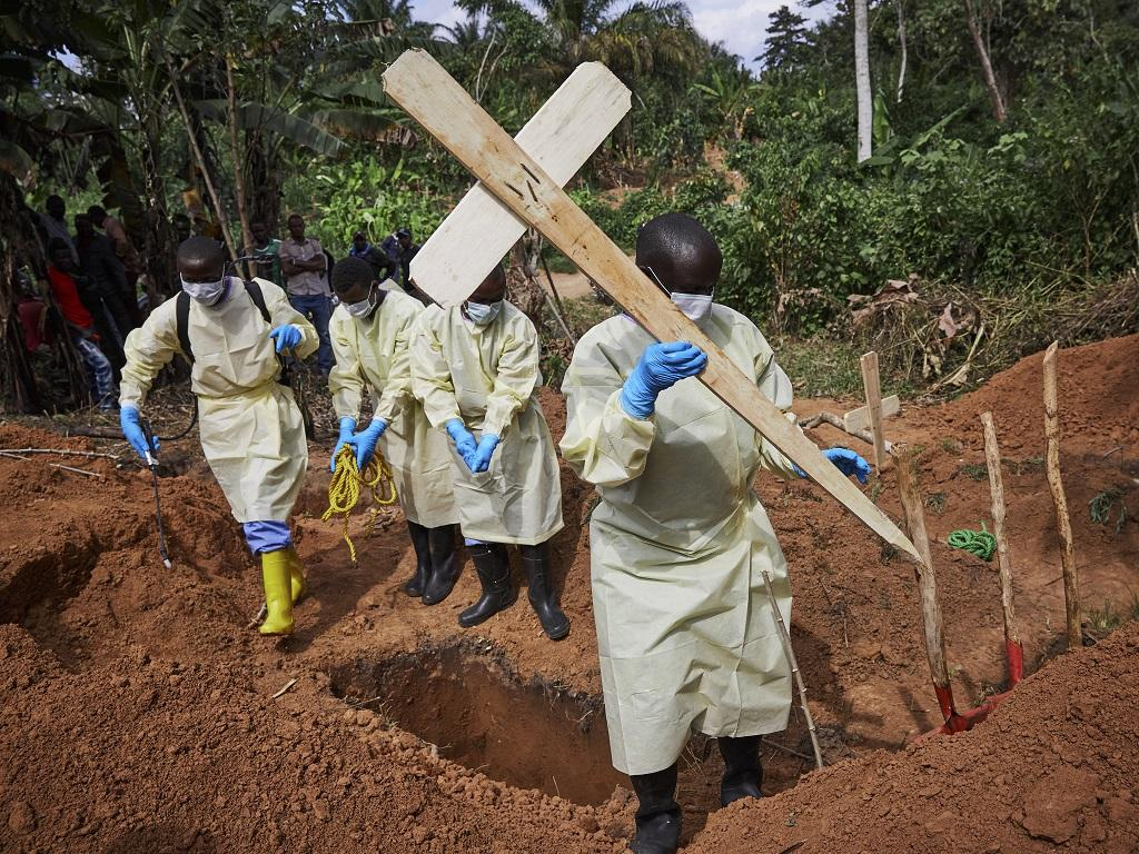 Health workers burying a child who died of Ebola in the DRC's North Kivu province. Photo: Hugh Kinsella Cunningham/EPA